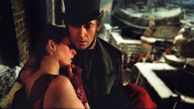 "Jean Valjean (HUGH JACKMAN) embraces a very ill Fantine (ANNE HATHAWAY) in ""Les Misérables"", Photo Credit: Laurie Sparham. Copyright: © 2012 Universal Studios. ALL RIGHTS RESERVED."