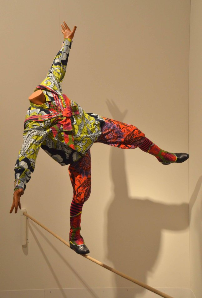 "Yinka Shonibare, MBE, ""Boy on Tightrope"", 2012, Mannequin, Dutch wax on printed cotton, fiberglass, leather and rope, Gallery: James Cohan Gallery"