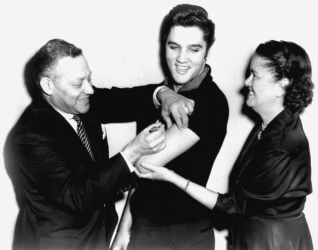 Elvis Pressley receiving the Salk Polio vaccine in 1956
