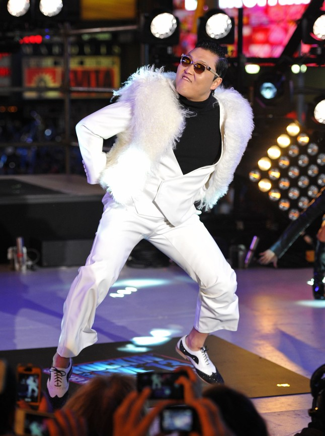 NEW YORK, NY - DECEMBER 31: Korean Rapper PSY performs during New Year's Eve 2013 In Times Square at Times Square on December 31, 2012 in New York City. (Photo by Mike Coppola/Getty Images)