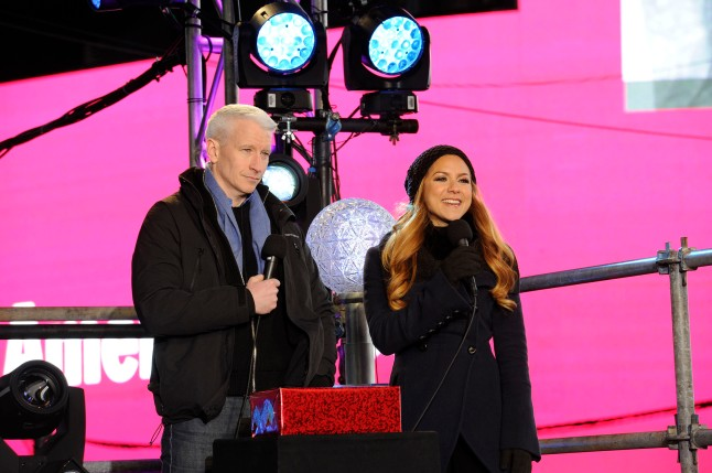 NEW YORK, NY - DECEMBER 31: Anderson Cooper (left) at Times Square on December 31, 2012 in New York City. (Photo by Eugene Gologursky/Getty Images)