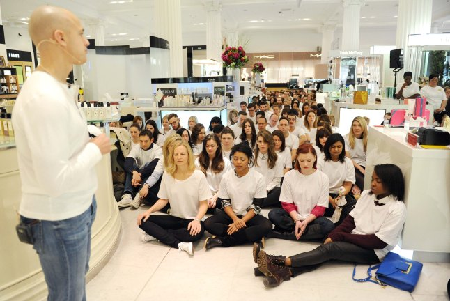 LONDON, UNITED KINGDOM - JANUARY 10: Five hundred people gather for a mass meditation led by Andy Puddicombe, Co founder of HEADspace and Alannah Weston, Selfridges Creative Director to launch No Noise at Selfridges on January 10, 2013 in London, England. (Photo by Stuart Wilson/Getty Images for Selfridges)