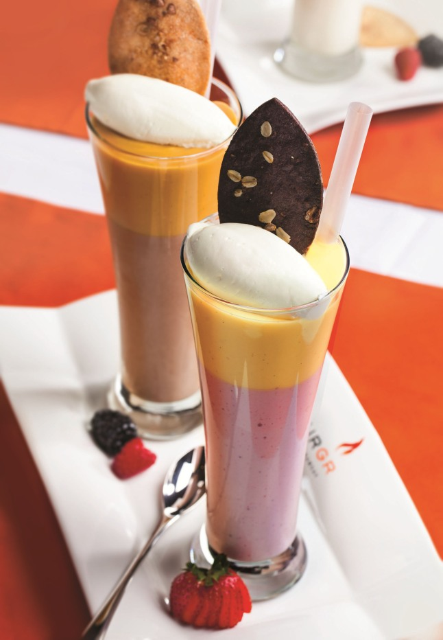Pudding Shakes, a Gordon Ramsay creation exclusive to BurGR, are creamy handspun milkshakes topped with intensely flavored pudding.  Flavors include coconut pudding with strawberry shake topped with a chocolate cookie and chocolate hazelnut pudding with coffee shake topped with a praline cookie. Gordon Ramsay BurGr is now open for lunch and dinner inside Planet Hollywwod Resort and Casino in Las Vegas. Photo courtesy of Planet Hollywood Resort & Casino.  (PRNewsFoto/Caesars Palace Las Vegas)