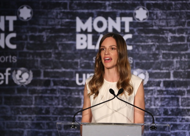 "LOS ANGELES, CA - FEBRUARY 23: Hilary Swank wearing Montblanc Princesse Grace de Monaco Collection in Red Gold and diamonds attends a Pre-Oscar charity brunch hosted by Montblanc and UNICEF to celebrate the launch of their new ""Signature For Good 2013"" Initiative with special guest Hilary Swank at Hotel Bel-Air on February 23, 2013 in Los Angeles, California. (Photo by Lester Cohen/Getty Images for Montblanc)"