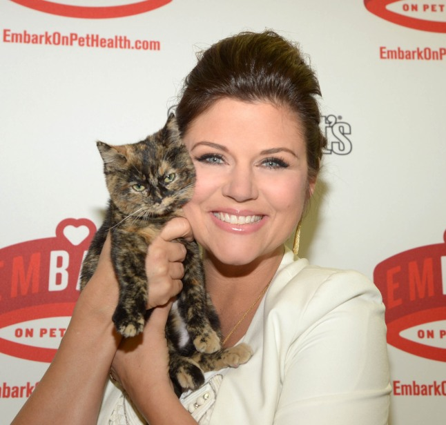 Actress and animal advocate, Tiffani Thiessen, visits the Bergen County Animal Shelter  in Teterboro, NJ on Tuesday, February 5, to kick off Sergeant's Pet Care Products' emBARK on Pet Health campaign. Pet owners take a simple pledge to become more mindful of their pet's overall health needs and for every pledge, Sergeant's is committed to donating up to 5,000 Pet Health Kits to shelters nationwide with the help of American Humane Association. While at the shelter, Tiffani was able to conduct some of the most important routine tasks in keeping pets healthy every day including playtime, grooming and teeth brushing.  (PRNewsFoto/Sergeant's)