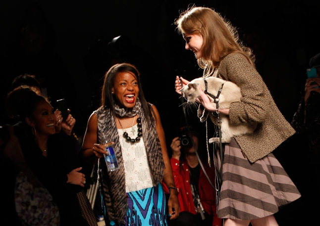 Purina ONE and designer Tracy Reese, left, showcase the True Nature of cats during the Tracy Reese Fall 2013 show at Fashion Week as part of their Healthy Metabolism launch, Sunday, Feb. 10, 2013. (Jason DeCrow/Invision for Purina ONE/AP Images)