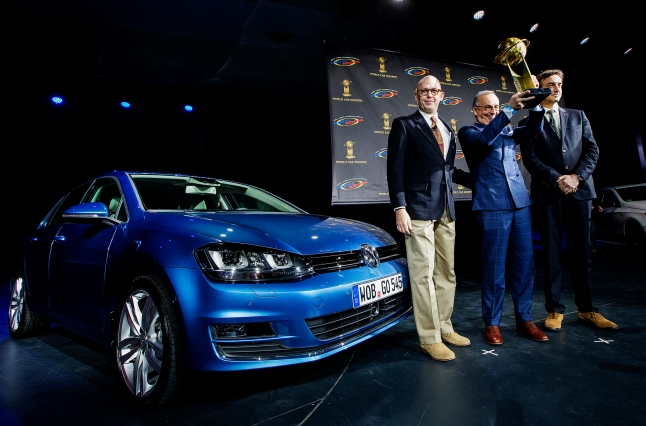 Head of Design of the Volkswagen Group Walter de'Silva, centre, poses for a photo with World Car Award co-chairs Matt Davis, left, and Peter Lyon, right, after the Volkswagen Golf was named the World Car of the Year at a press conference during the New York International Auto Show on Thursday, March 28, 2013. (Photo By: Michelle Siu for the World Car Awards)