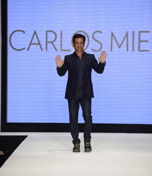 Designer Carlos Miele taking a well-deserved bow at the end of his fall/winter 2013 Fashion at Miami Fashion Week 2013 at the Miami Beach Convention Center. (Provided by Becky Levin/Paul Wilmot Communications for Miami Fashion Week 2013)