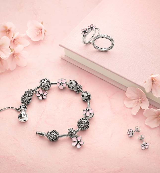 Explore the ever-changing splendor of pink cherry blossoms set in sterling silver or 14k gold.