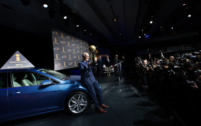 Head of Design of the Volkswagen Group Walter de'Silva poses for a photo with the Volkswagen Golf that was named the World Car of the Year at a press conference during the New York International Auto Show on Thursday, March 28, 2013. (Photo By: Michelle Siu for the World Car Awards)