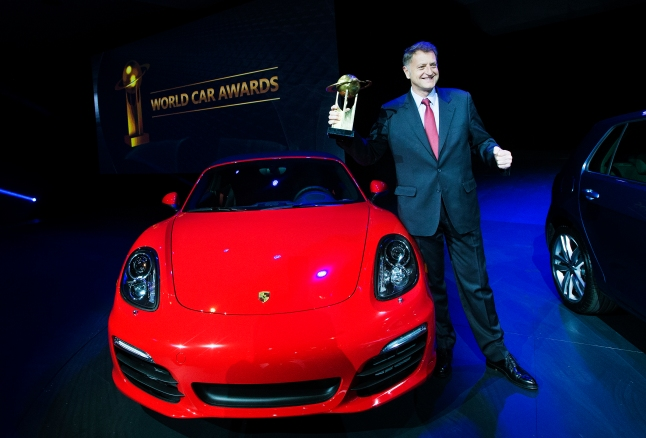 President and CEO of Porsche Cars North America Detlev von Platen poses for a photo as he accepts the World Performance Car of the Year award for the Porsche Boxster / Cayman at a press conference during the New York International Auto Show on Thursday, March 28, 2013. (Photo By: Michelle Siu for the World Car Awards)