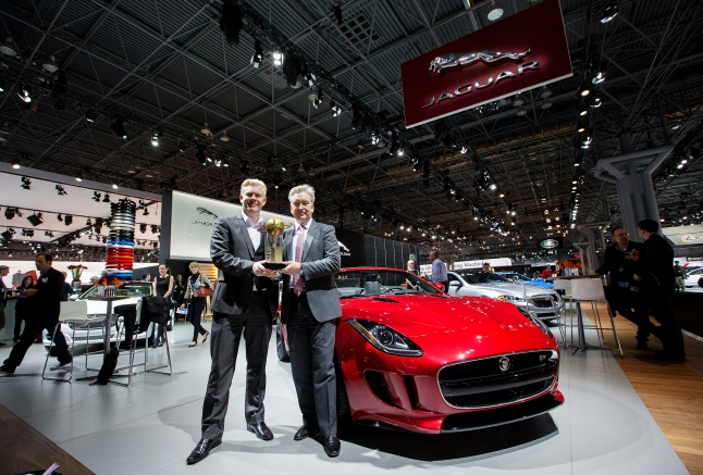 Jaguar production studio director, left, and global brand director Adrian Hallmark, right, pose for a photo at the New York International Auto Show with the Jaguar F-Type after it was newly named the 2013 World Car Design of the Year at the 2013 World Car Awards press conference on Thursday, March 28, 2013. (Photo By: Michelle Siu for the World Car Awards)