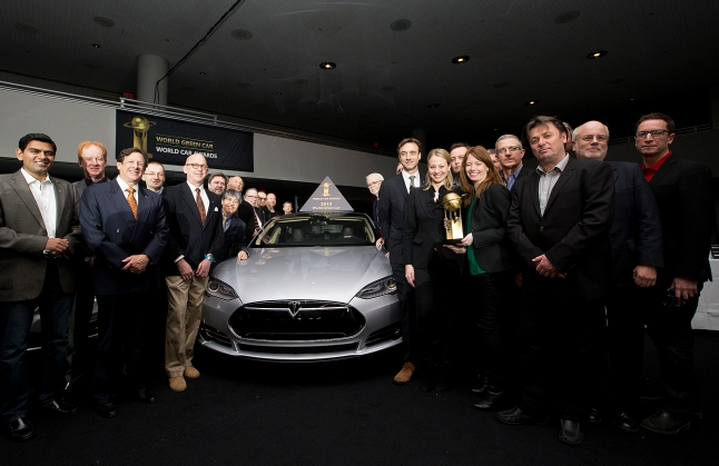Jurors pose for a photo with the Tesla Model S which has been named the World Green Car at the World Car Awards press conference during the New York International Auto Show on Thursday, March 28, 2013. (Photo By: Michelle Siu for the World Car Awards)