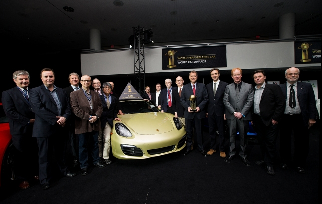 President and CEO of Porsche Cars North America Detlev von Platen holds the trophy for the World Performance Car as he poses for a photo with jurors following the World Car Awards press conference during the New York International Auto Show on Thursday, March 28, 2013. (Photo By: Michelle Siu for the World Car Awards)
