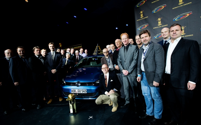 Jurors pose for a photo with the Volkswagen Golf after it was named the World Car of the Year during the World Car Awards press conference at the New York International Auto Show on Thursday, March 28, 2013. (Photo By: Michelle Siu for the World Car Awards)