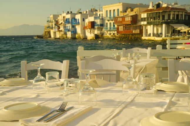 Seaside dinner tables at Mykonos sunset.  (PRNewsFoto/Crystal Cruises)