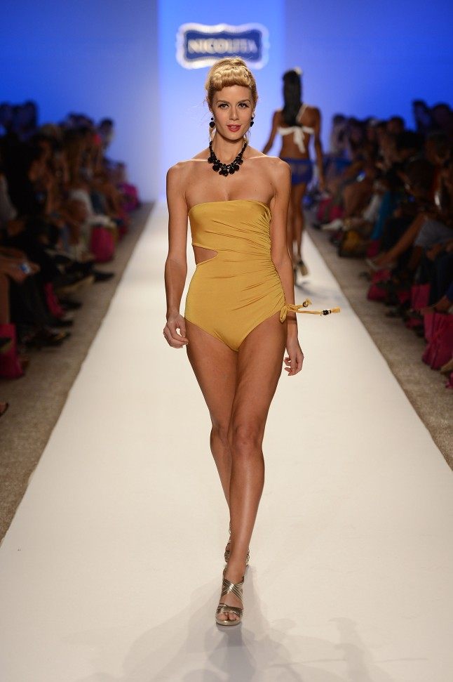 A model walks the runway at the Nicolita show during Mercedes-Benz Fashion Week Swim 2013 at The Raleigh on July 20, 2012 in Miami Beach, Florida.