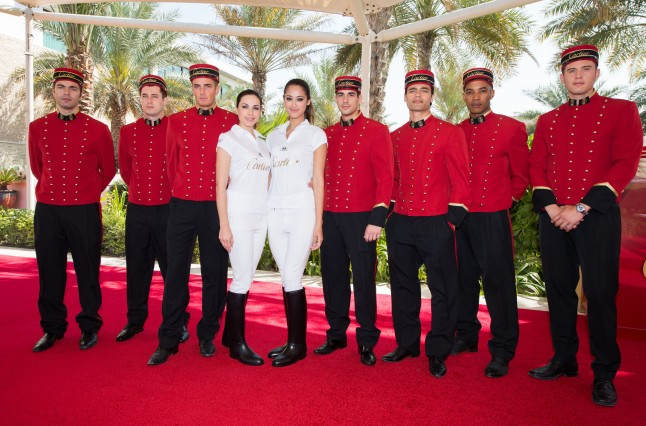 DUBAI, UNITED ARAB EMIRATES - FEBRUARY 22: Cartier models are seen  during final day at the Cartier International Dubai Polo Challenge at the Desert Palm Hotel on February 22, 2013 in Dubai, United Arab Emirates. The event takes place under the patronage of HRH Princess Haya Bint Al Hussein, wife of HH Sheikh Mohammed Bin Rashid Al Maktoum, Vice President and Prime Minister of UAE Ruler of Dubai. The Cartier International Dubai Polo Challenge is the most celebrated tournament in the desert and one of three Cartier hosts each year including the Royal Cartier International Windsor Polo and Saint-Moritz Snow Polo event. (Photo by Ian Gavan/Getty Images for Cartier)
