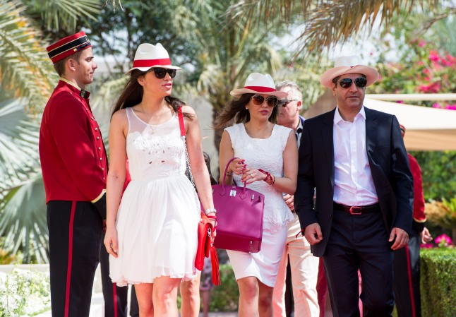 DUBAI, UNITED ARAB EMIRATES - FEBRUARY 22: Guests arrive during final day at the Cartier International Dubai Polo Challenge at the Desert Palm Hotel on February 22, 2013 in Dubai, United Arab Emirates. The event takes place under the patronage of HRH Princess Haya Bint Al Hussein, wife of HH Sheikh Mohammed Bin Rashid Al Maktoum, Vice President and Prime Minister of UAE Ruler of Dubai. The Cartier International Dubai Polo Challenge is the most celebrated tournament in the desert and one of three Cartier hosts each year including the Royal Cartier International Windsor Polo and Saint-Moritz Snow Polo event. (Photo by Ian Gavan/Getty Images for Cartier)