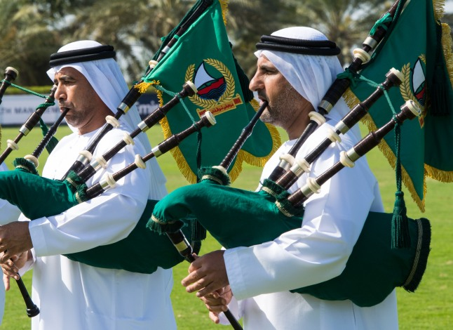 DUBAI, UNITED ARAB EMIRATES - FEBRUARY 22: A band plays bagpipes and drums on the polo field during final day at the Cartier International Dubai Polo Challenge at the Desert Palm Hotel on February 22, 2013 in Dubai, United Arab Emirates. The event takes place under the patronage of HRH Princess Haya Bint Al Hussein, wife of HH Sheikh Mohammed Bin Rashid Al Maktoum, Vice President and Prime Minister of UAE Ruler of Dubai. The Cartier International Dubai Polo Challenge is the most celebrated tournament in the desert and one of three Cartier hosts each year including the Royal Cartier International Windsor Polo and Saint-Moritz Snow Polo event. (Photo by Ian Gavan/Getty Images for Cartier)
