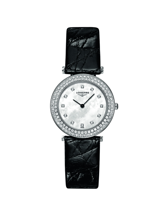 La Grande Classique de Longines 100 Diamonds adds a touch of timeless elegance to Longines' emblematic collection. The ultra-slim stainless-steel case set with 100 diamonds has a diameter of 29 mm and is fitted with the quartz movement L209. The mother-of-pearl dial with 12 diamond indices and the black baton hands underline the beauty of this ultra-slim timepiece which is rounded off with a black alligator strap.