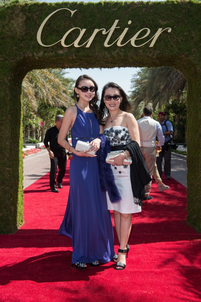 DUBAI, UNITED ARAB EMIRATES - FEBRUARY 22: Connie Huan Huan and guest attend final day at the Cartier International Dubai Polo Challenge at the Desert Palm Hotel on February 22, 2013 in Dubai, United Arab Emirates. The event takes place under the patronage of HRH Princess Haya Bint Al Hussein, wife of HH Sheikh Mohammed Bin Rashid Al Maktoum, Vice President and Prime Minister of UAE Ruler of Dubai. The Cartier International Dubai Polo Challenge is the most celebrated tournament in the desert and one of three Cartier hosts each year including the Royal Cartier International Windsor Polo and Saint-Moritz Snow Polo event. (Photo by Ian Gavan/Getty Images for Cartier)
