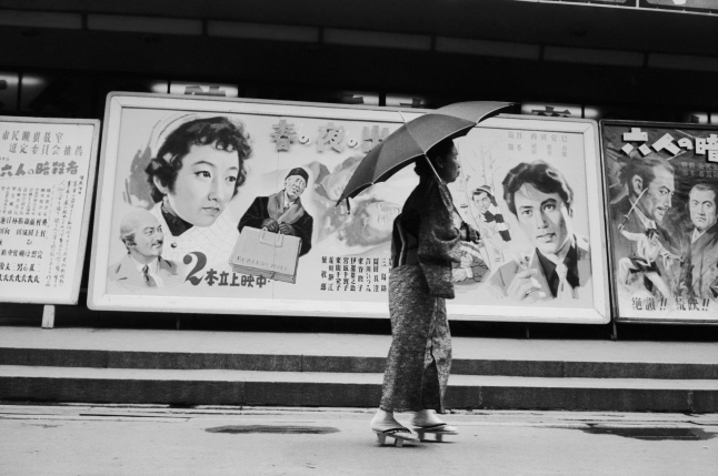 A woman walking past a line of advertising posters in Hiroshima, July 1955. Original Publication: Picture Post - 7849 - Hiroshima - pub. 1955  (Photo by John Chillingworth/Picture Post/Hulton Archive/Getty Images)