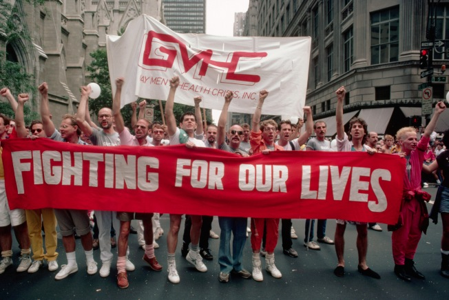 """Gay Protesters on Gay Pride  - July 1985, Manhattan, New York City, New York State, USA --- Protesters hold a red sign reading """"Fighting for Our Lives"""" during a Gay Pride Day march along Manhattan's Fifth Avenue. --- Image by © Owen Franken/CORBIS"""
