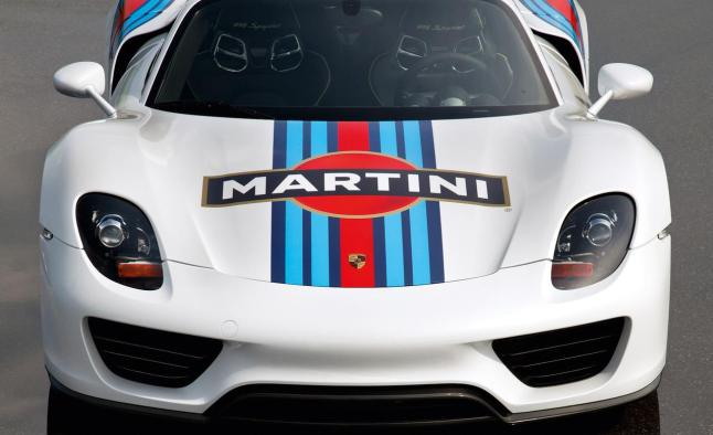 MARTINI® and Porsche reignite their legendary relationship as the distinctive dark blue, light blue and red stripes of MARTINI® Racing are seen for the first time since 2008