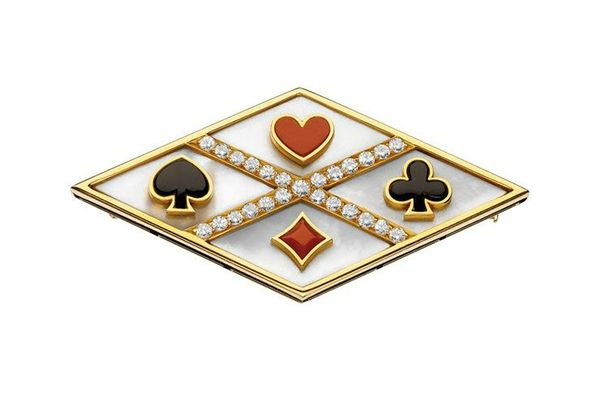Bulgari. 'Playing Card' brooch, ca. 1975 – Gold with mother-of-pearl, coral, onyx and diamonds. Courtesy of de Young Museum