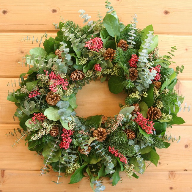 Ignite holiday spirit with Creekside Farms' Fragrant Berries and Cones wreath, hand made with a blend of traditional evergreen and California greens and accented with vibrant pepper berries and pinecones.  (PRNewsFoto/Creekside Farms)