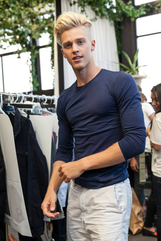 Backstage photo of a model getting dressed at this year's Mack Weldon / Raleigh New York Fashion Week presentation.  This event featured Mack Weldon products tucked under, and complementing, Raleigh's SS'14 line. Boxer briefs, trunks, undershirts and socks were subtly featured beneath Raleigh Denim's blue jeans and button downs and Cole Hann footwear.  (PRNewsFoto/Mack Weldon)