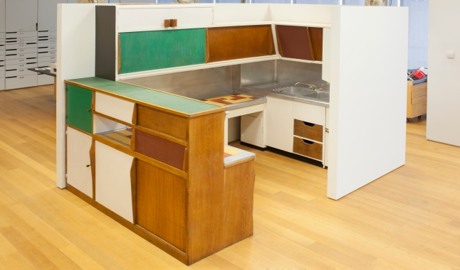 Charlotte Perriand (French, 1903–1999), with Le Corbusier (Charles-Édouard Jeanneret; French, born Switzerland. 1887–1965), and ATBAT. Kitchen from the Unité d'Habitation, Marseille, France. c. 1952. Various materials, 88 x 105 1/2 x 72″ (223.5 x 268 x 182.9 cm). Mfr.: Charles Barberis, Menuiseries modernes, Corsica. The Museum of Modern Art, New York. Gift of Andrea Woodner, 2011