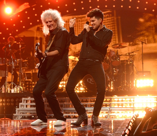 LAS VEGAS, NV - SEPTEMBER 20:  Adam Lambert and Brian May perform onstage during the iHeartRadio Music Festival at the MGM Grand Garden Arena on September 20, 2013 in Las Vegas, Nevada.  (Photo by Kevin Mazur/Getty Images for Clear Channel)
