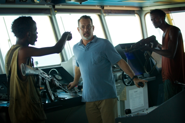 "L-r, Barkhad Abdi, Tom Hanks and Faysal Ahmed star in Columbia Pictures' ""Captain Phillips"", a high-stakes thriller based on true story of the 2009 hijacking of the U.S. container ship Maersk Alabama by a crew of Somali pirates"