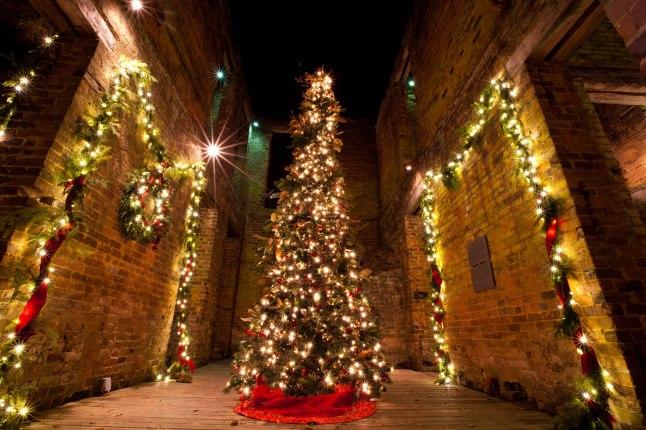 Colorful lights adorn the walls and Christmas tree inside The Ruins at Barnsley Resort. (Jessica Rayborn Photography)