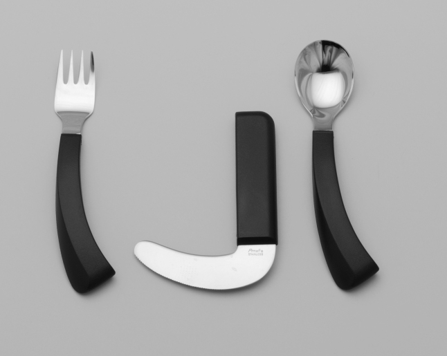 Karin Schou Andersen (Danish, born 1953). Flatware. 1979. ABS polymer and stainless steel, fork: 7 1/8 x 1 1/2 x 5/8″ (18.1 x 3.8 x 1.6 cm), spoon: 7 1/4 x 1 3/4 x 3/4″ (18.4 x 4.5 x 1.9 cm), knife: 5 1/4 x 4 x 5/8″ (13.3 x 10.2 x 1.6 cm). Mfr.: Amefa Alpeldoornse, Apeldoorne, The Netherlands. The Museum of Modern Art, New York. Gift of the manufacturer