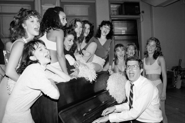 "09 Sep 1986 --- Broadway composer Marvin Hamlisch sings with a group of young actresses during rehearsals for his musical ""Smile"". --- Image by © Bettmann/CORBIS"