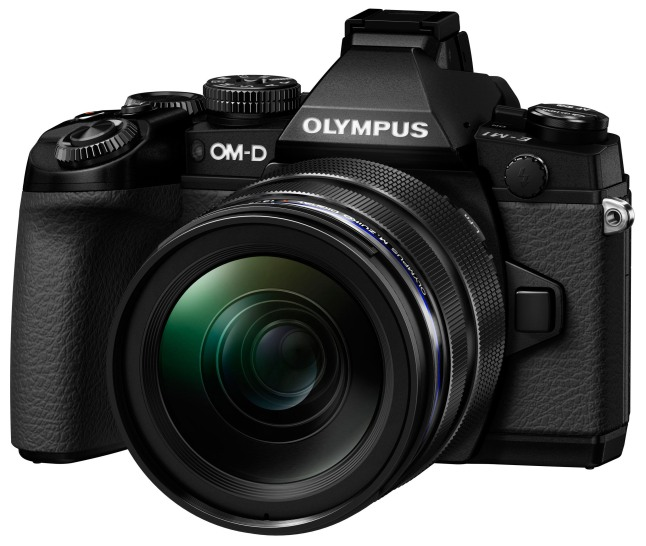 Olympus introduces the OM-D E-M1(R), its new premium flagship camera and worthy successor to its E-5 DSLR. As powerful as a pro DSLR, the E-M1 is a compact system camera with a revolutionary design made for advanced photographers who demand incredible speed and image quality in a lightweight go-anywhere durable body.  (PRNewsFoto/Olympus Imaging America Inc.)