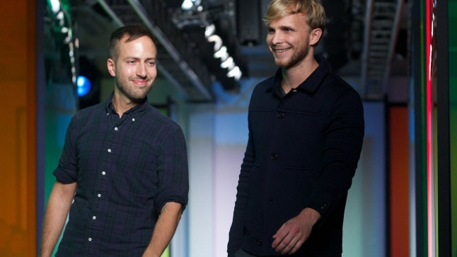 Designers Peter Pilotto and Christopher De Vos greet the audience following the 2014 Spring/Summer Peter Pilotto catwalk show during the London Fashion Week in London on September 16, 2013. AFP PHOTO / ANDREW COWIE        (Photo credit should read ANDREW COWIE/AFP/Getty Images)