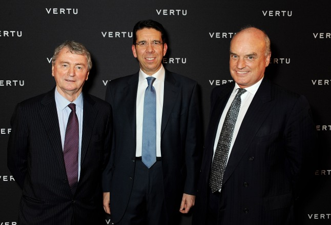 LONDON, ENGLAND - OCTOBER 02: (L to R) Stephen Quinn, Vertu CEO Massimiliano Pogliani and Nicholas Coleridge attend the Vertu launch of the new Constellation smartphone at One Mayfair on October 2, 2013 in London, England. (Photo by David M. Benett/Getty Images for Vertu)