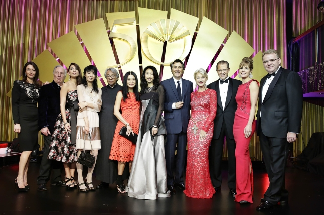 L to R Mary McCartney,  Frederick Forsyth, Caterina Murino, Maggie Cheung, Sir David Tang, Vivienne Tam, Karen Mok, Bryan Ferry, Dame Helen Mirren, Edouard Ettedgui, Darcey Bussell and Jonas Schuermann at Mandarin Oriental Hong Kong's 50th Anniversary Gala on October 17 2013 in Hong Kong Photo by Jessica Hromas Getty Images for the Mandarin Oriental Hotel Group