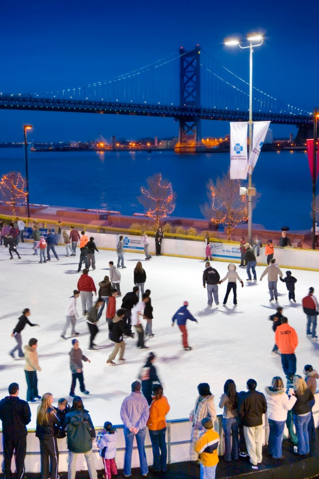 RiverRink in Philadelphia on Sunday, Dec. 31, 2006.: Skaters glide on ice against a picturesque backdrop at the Blue Cross RiverRink at Penn's Landing. Visitors can beat the chill with activities and snacks in the warming pavilion. Credit: Photo by G. Widman for GPTMC