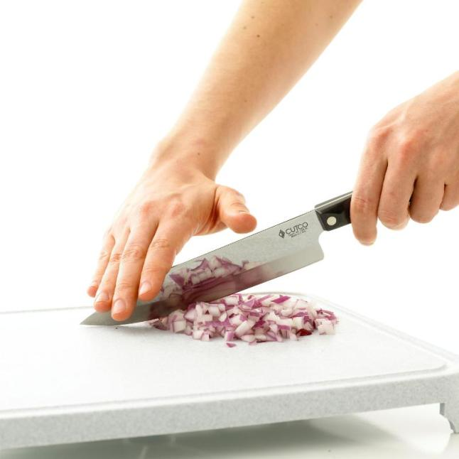Chef knives are go-to knives for all the chopping, dicing and mincing required during the holidays.    (PRNewsFoto/CUTCO Cutlery)