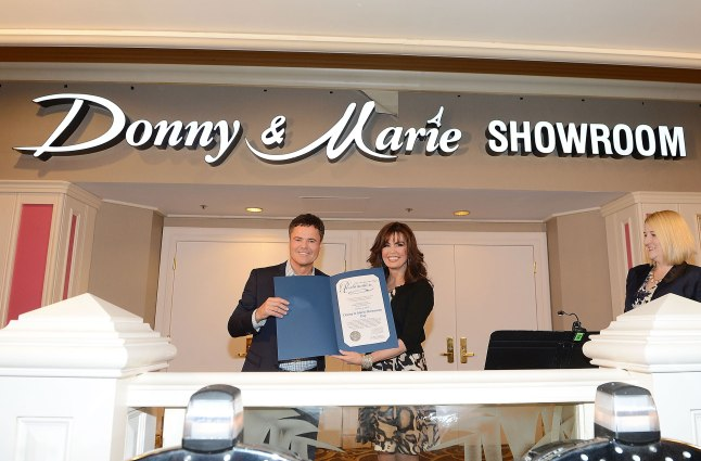 Flamingo Las Vegas headliners Donny and Marie hold up the proclamation from the Mayor of Las Vegas naming October 2, 2013 ''Donny & Marie Showroom Day''