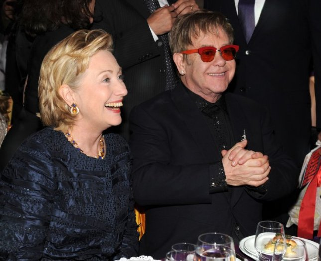 Hillary Rodham Clinton and Elton John attend the Elton John AIDS Foundation's 12th Annual An Enduring Vision Benefit at Cipriani Wall Street on October 15, 2013 in New York City.