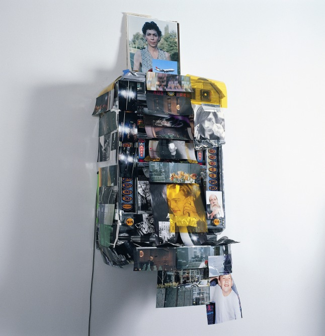 Isa Genzken Spielautomat (Slot Machine), 1999-2000 Slot machine, paper, chromogenic color prints, and tape 63 x 25 9/16 x 19 11/16″ (160 x 65 x 50 cm) Private Collection, Berlin Courtesy Galerie Buchholz, Cologne/Berlin © Isa Genzken
