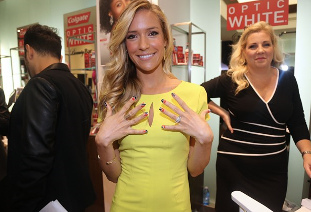 Kristin Cavallari showing her LOVE for her Chicago Bear Husband- Jay Kutler, showing her nail art at the Colgate Optic White Beauty Bar