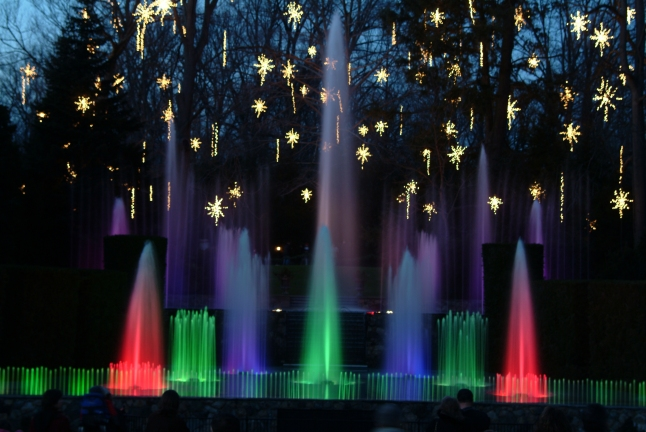Some 400,000 decorative lights glitter in the trees, while colorful fountain displays set to music enchant holiday revelers at Longwood Gardens.