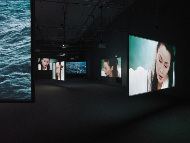 """Isaac Julien. Ten Thousand Waves. 2010. Installation view, Bass Museum of Art, Miami. Nine-screen installation, 35mm film transferred to High Definition 9.2 surround sound, 49' 41"""".  Courtesy of the artist, Metro Pictures, New York and Victoria Miro Gallery, London. Photograph: Peter Haroldt"""